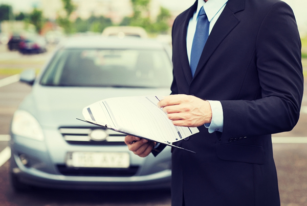 Man reviewing car loan documentation